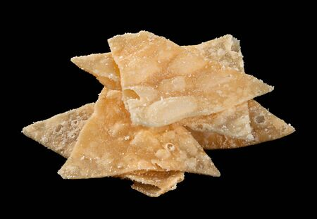 spice isolated: Triangle flour chips snack with spice isolated on black
