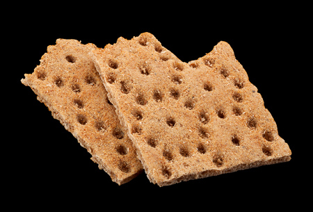 Low calories snack bread isolated on black background