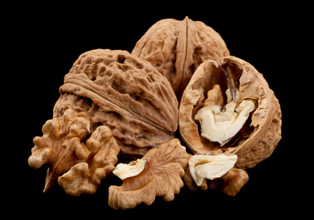 Walnut fruit closeup isolated on black background