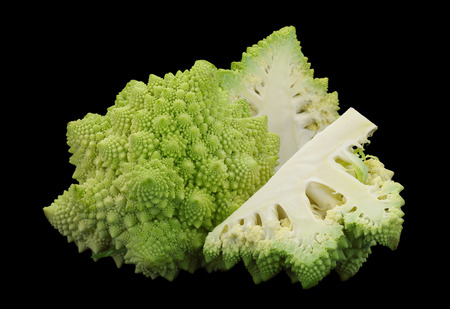 Romanesco cabbage iolsted on black background