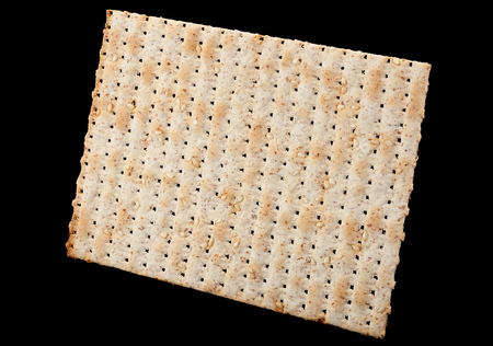 Matzo traditional jewish bread isolated on black Stock Photo