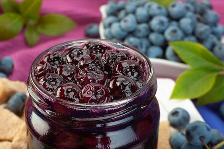 Blueberry berries sweet jam closeup in glass can