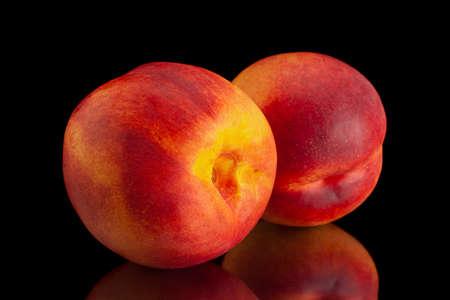 Ripe nectarine fruit isolated on black background