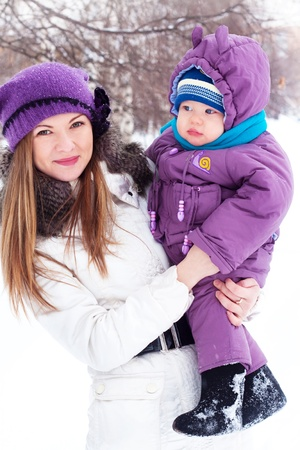 girl, woman, mother, mother, love, family, trip, vacation, blonde, a little boy, baby, sits in the snow, snowball, baby boy, son, snowman, snow, snowballs, snowflakes, sculpt, dig, a white man, winter, cold, park, forest, smiling, playing, fun, happy, sun Stock Photo - 8684632