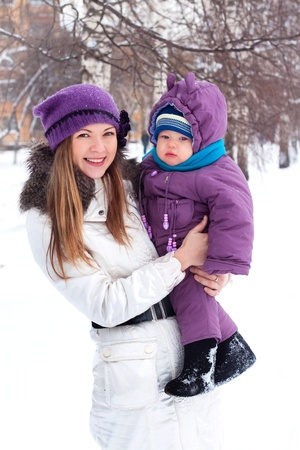 girl, woman, mother, mother, love, family, trip, vacation, blonde, a little boy, baby, sits in the snow, snowball, baby boy, son, snowman, snow, snowballs, snowflakes, sculpt, dig, a white man, winter, cold, park, forest, smiling, playing, fun, happy, sun photo
