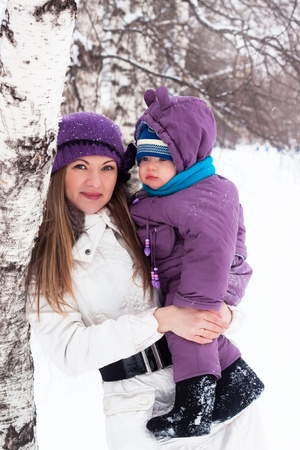 Winter's day a happy family, mom and baby, snow, park, walk Stock Photo - 8684629