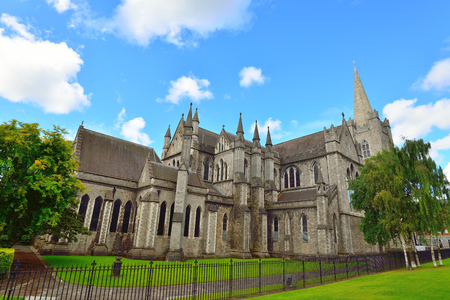 St Patrick's Cathedral, Dublin during summer. Green grass and blue sky.