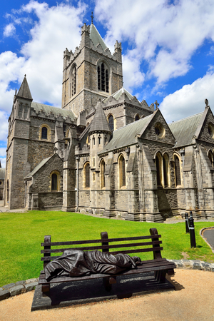 Christ Church Cathedral and black metal statue of bench and a man