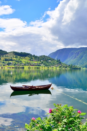 Beautiful scenery of a boat in Ulvik, Norway.
