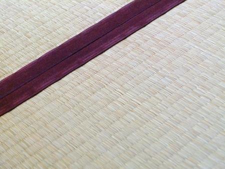 Tatami mat closeup with violet edging (heri). Straws visible. Banco de Imagens