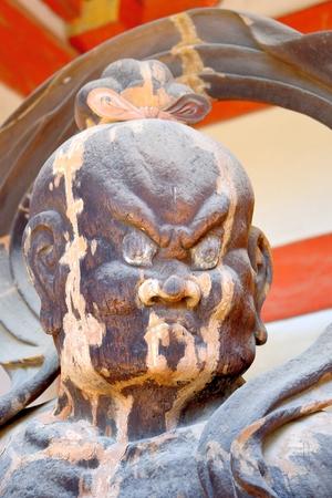 Face of Ungyo statue at Fushimi Inari Taisha, Kyoto, Japan.