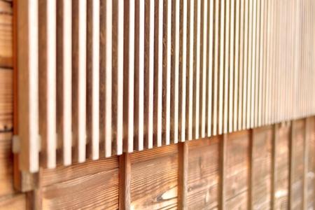 Wooden lattice window (koushimado) in Japanese style. Closeup on the lattices. Kanazawa, Japan.