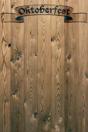 Oktoberfest banner on old wooden texture