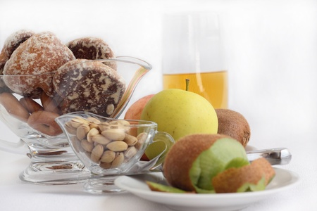 horizontally: Fruit, nutlets, gingerbreads and juice on a gray background  Horizontally
