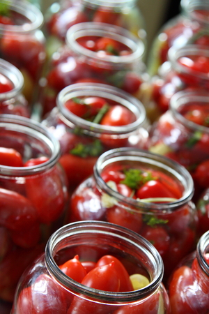 preservation: Tomatoes, greens, pepper sweet in glass jars. Preparation for preservation.