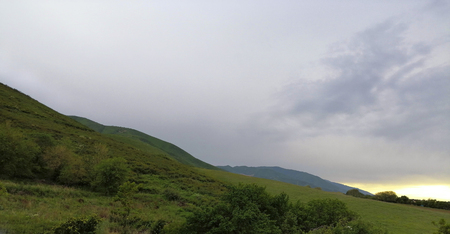 mountains before the rain and storm. gray clouds. it will rain soon Mainly cloudy. coldly. 스톡 콘텐츠