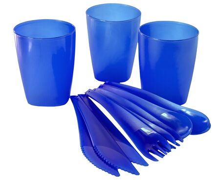 Disposable plastic picnic utensils. Bright set of dishes. Cutlery.