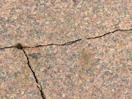 Cracked sidewalk. After the earthquake. Crack on the floor. The texture with destruction. Background.