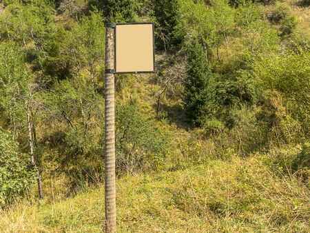 A wooden signpost shows the direction of the path in the mountains. Campaign Orienteering. 版權商用圖片