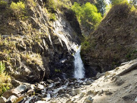 Stream with clear transparent water in the mountains. Water source. Mineral water in nature. Stock fotó