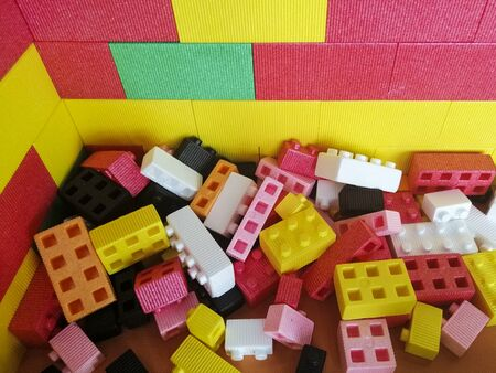 Large foam building blocks for a child s playroom. Multi-colored bright toys. Destky playroom. Entertainment for children. Childhood.