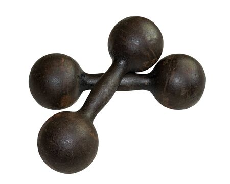 Old iron rusty dumbbell. Sports equipment. Dumbbell for the gym and sports. Weightlifting. Heavy kettlebell.
