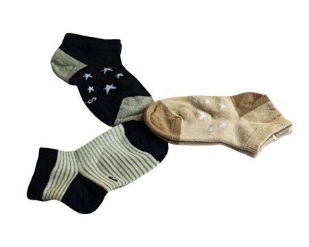 Three pairs of cotton socks. Striped pattern and star pattern. Childrens socks. Cotton. Isolated item