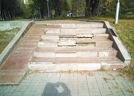 Poorly made steps in the park. The stairs are ruined and broken. Bribe and corruption