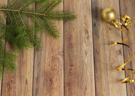 Decoration for christmas on a wooden background. Christmas tree branch and balls for the Christmas tree. New Year celebration. Copyspace.