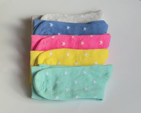 Childrens multi-colored socks with a pattern of stars. Top view, isolated. Many different socks for the cold seasons