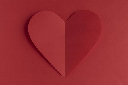 Red paper heart on a red background. Valentine's Day. Valentine's Day. Love and heart. Stock Photo - 137497485
