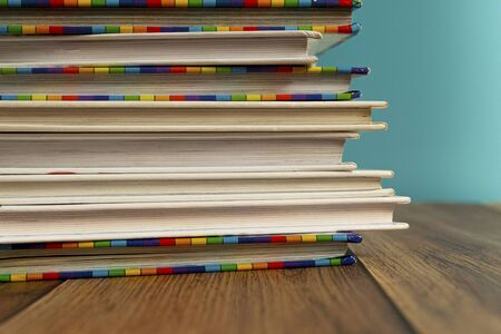 A stack of different bookmarks with bookmarks for pages. Book binding. Knowledge and education. Literature in the library.