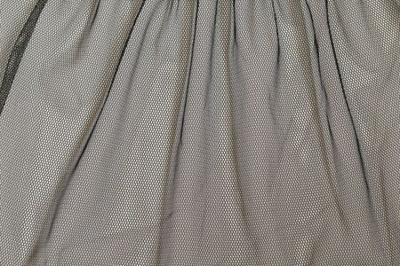 Abstract background texture of black tulle, shiny. Beautiful frill