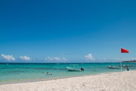 Quiet Caribbean Sea beach in Playa del Carmen, Yucatan, Mexico. Red flag.Lifesaver