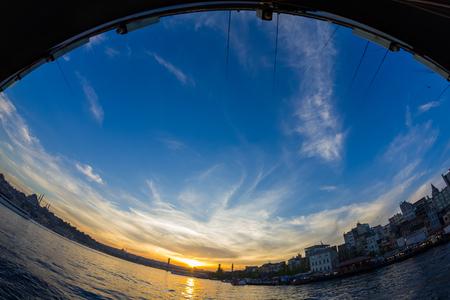 Sunset from Galata Bridge. Istanbul,Turkey Ships gulls. Fish-eye Stock Photo