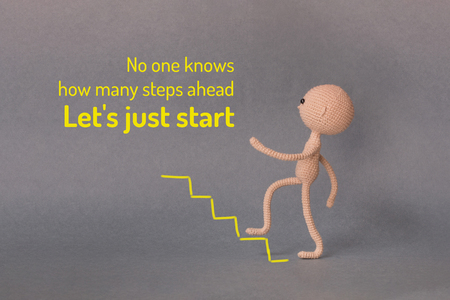A toy man on a gray background with copy space.  Motivational phrase. A sketch is drawn on top of the photo.Man climbs the stairs up