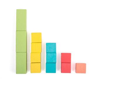 Toy wooden blocks as financial graph. Graph with five 5 steps. Real decreasing schedule. Infographic diagram, chart over white background. Multi-colored wooden blocks. Business concept.