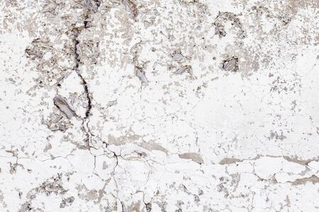 Cracked concrete texture background. Grey surface with cracks close up. Cracked grey old wall as background.