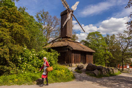 Stockholm, Sweden - 7 June 2019: Beautiful old windmill in Skansen park, Djurgarden Island, Stockholm, Sweden. Traditional mills in Scandinavia. Editorial