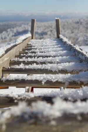 Snow-covered staircase. Stand for skiing and snowboards Foto de archivo