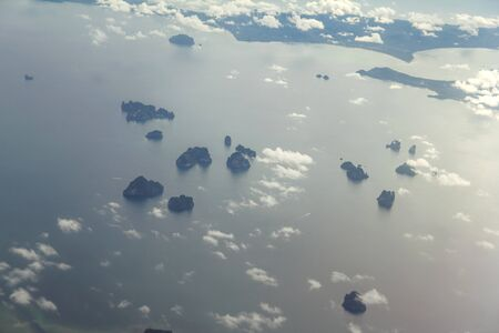 Blue sky with white clouds from the plane view.Cumulus clouds.Krabi Island, Thailand. Foto de archivo