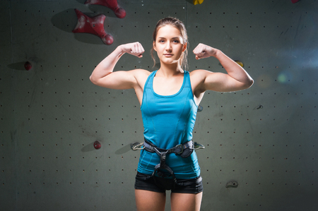 showing muscles: Athletic young woman showing muscles on hands