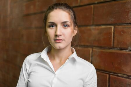 fullface: Portrait of a young beautiful business lady.