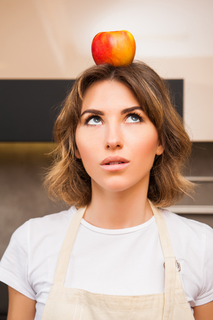 funny picture: Funny picture of a woman with an apple on her head