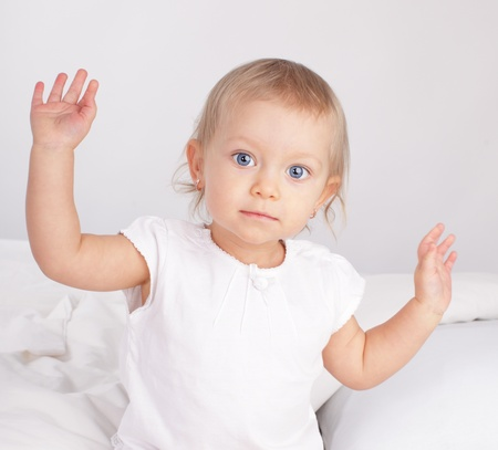 15 18: Beautiful baby in bed Stock Photo