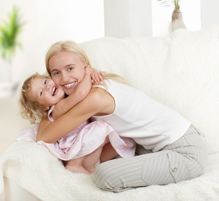 Happy mother with a daughter at home Stock Photo - 9239307