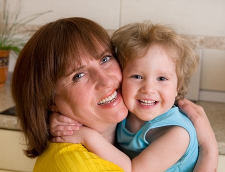 Happiness embracing grandmother with granddaughter Stock Photo - 9266463