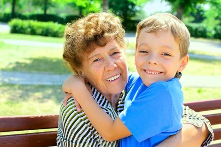 great grandmother: Happiness grandmother and grandson in the park. Series Stock Photo