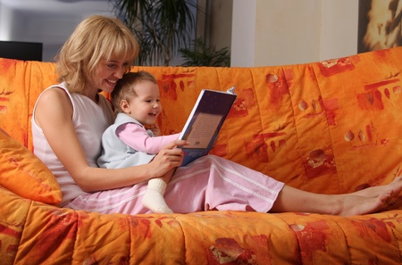Mum reads the book to a daughter Stock Photo - 9266695