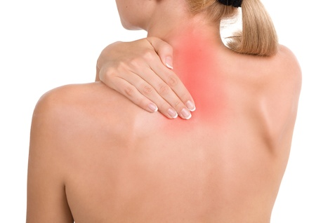 Woman holds a hand on pain neck. Backache photo